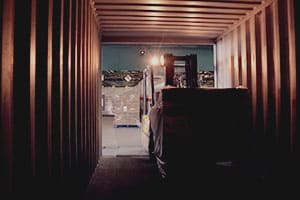 forklift truck unloading warehouse